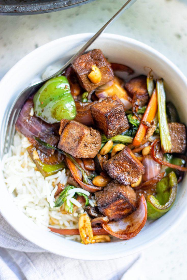 kung pao tofu with veggies over white rice