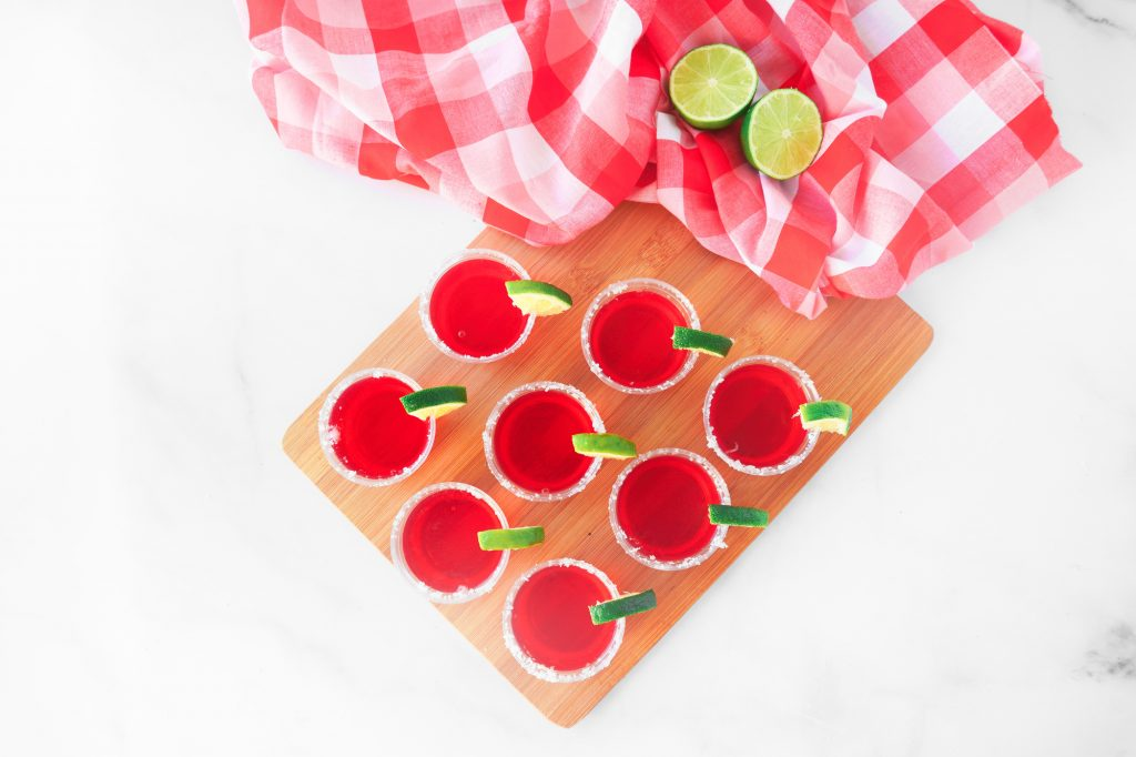 overhead shot of strawberry margarita vegan jello shots with lime