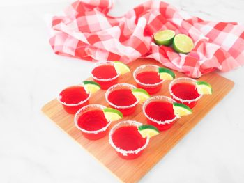 strawberry margarita vegan jello shots on tray with limes