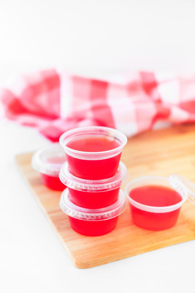 vegan jello shots in plastic containers with lids