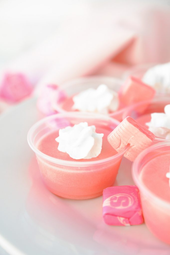 close up photo of pink starburst jello shots with starburst garnish