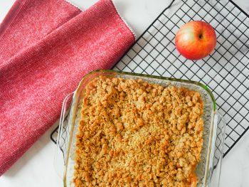 vegan apple crisp with apple on cooling rack
