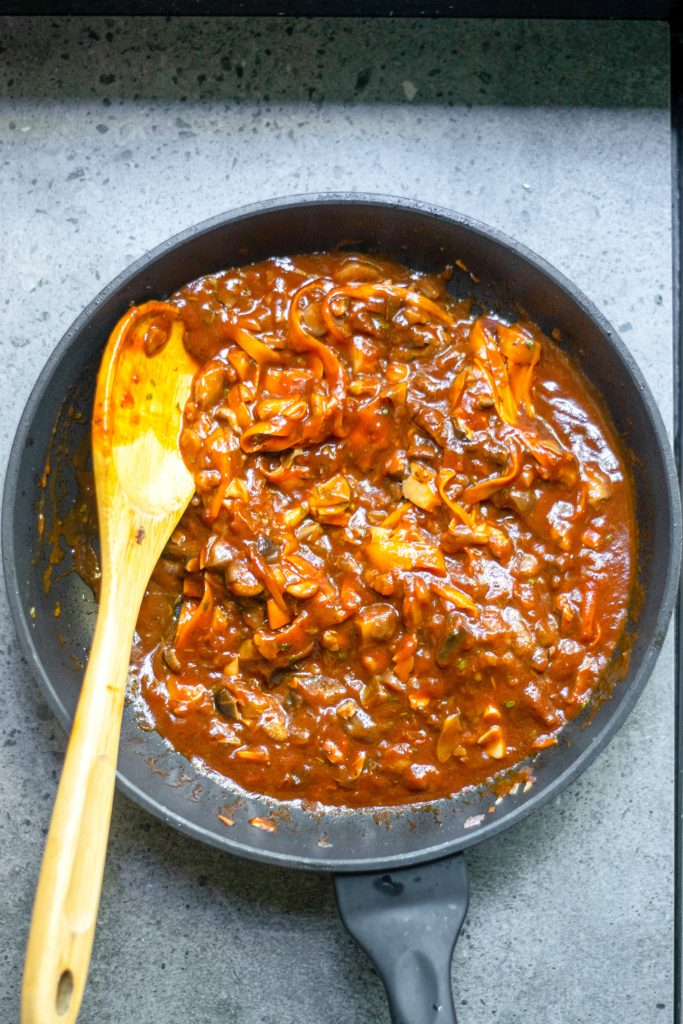 vegan bolognese sauce in pan during cooking
