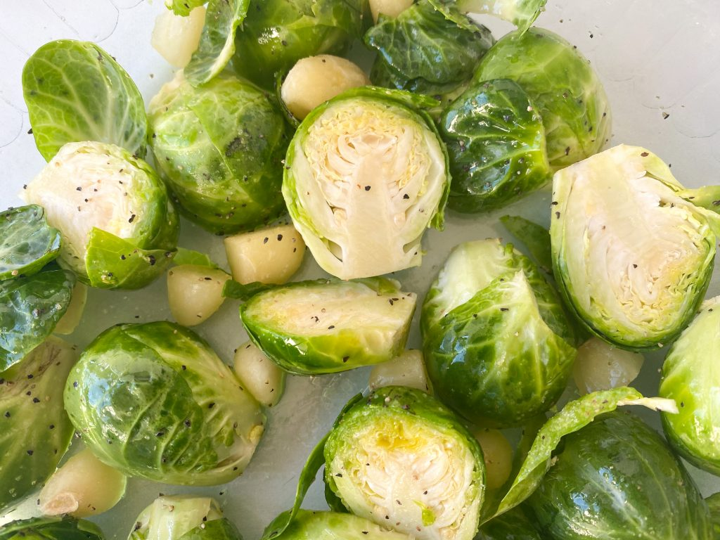 brussels sprouts before being cooked seasoned with garlic