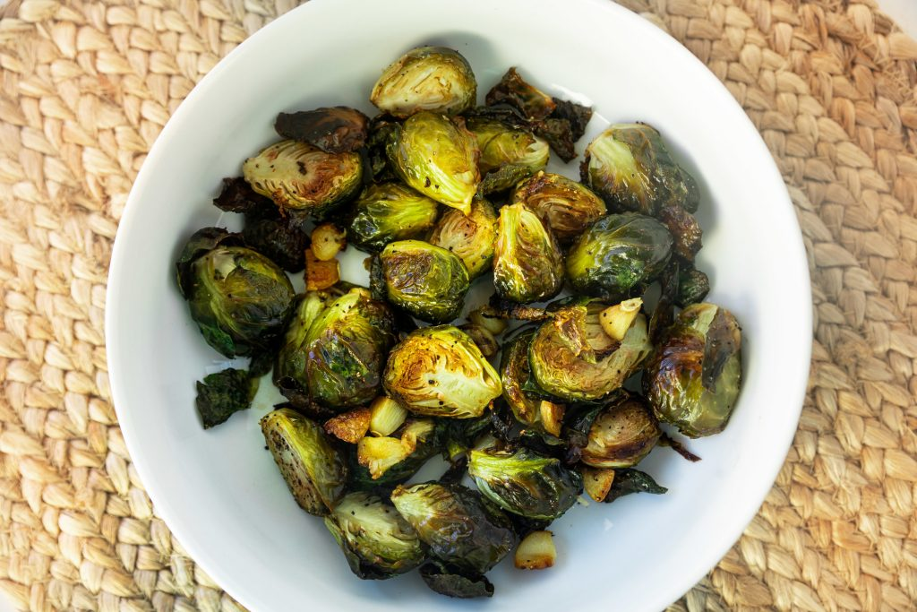 bowl of vegan brussels sprouts on brown placemat