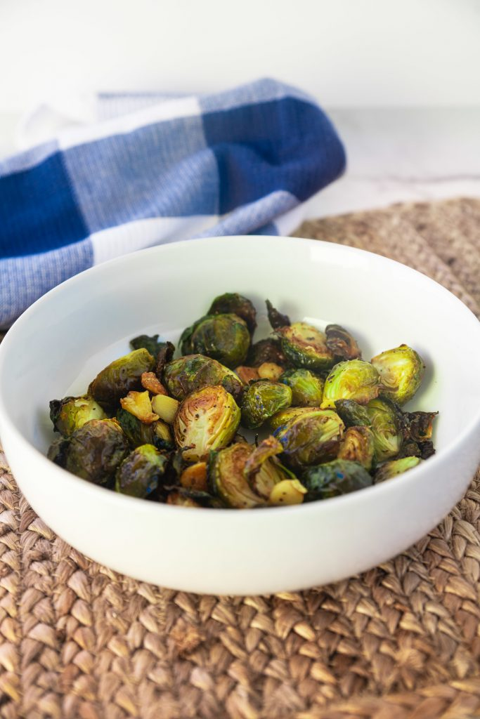 roasted vegan brussels sprouts with garlic in serving bowl