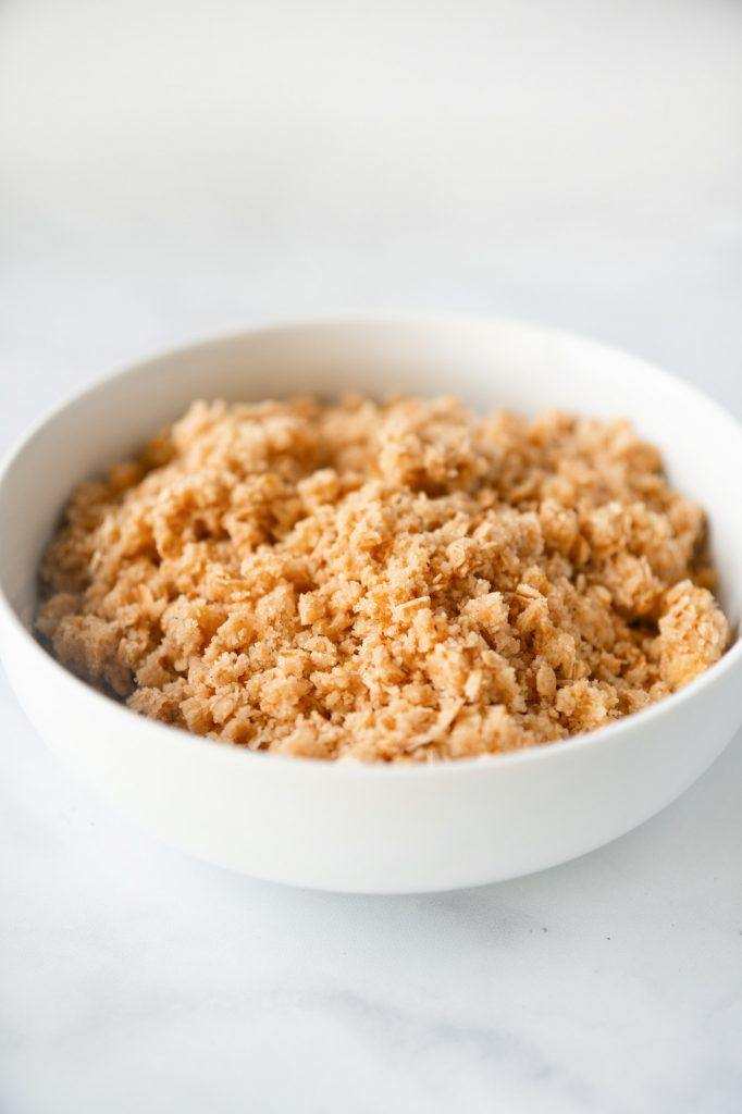 vertical photo of vegan crumble topping