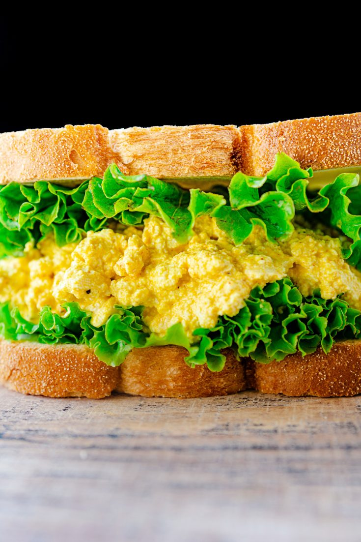 vegan egg salad sandwich on brown counter