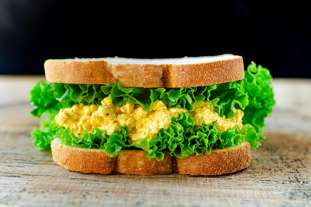 vegan egg salad sandwich with lettuce