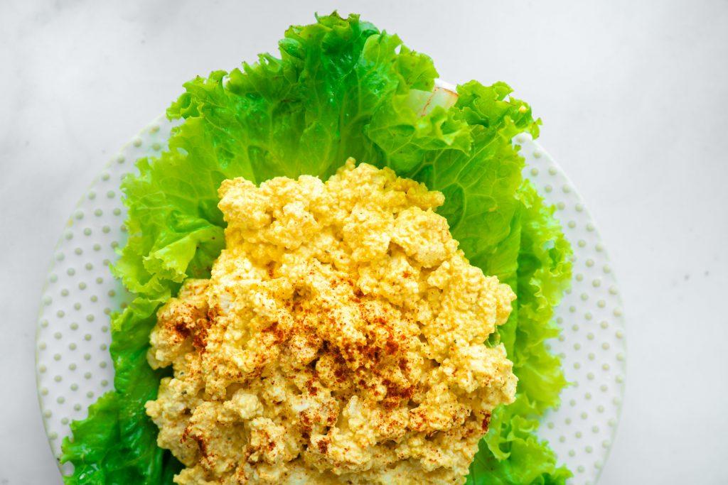 vegan egg salad on bed of lettuce