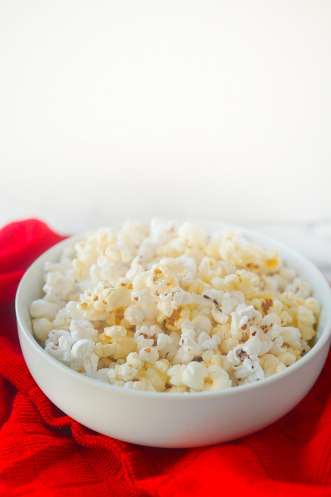 vegan popcorn with butter flavor on red towel