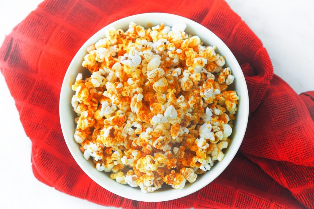 photo of nutritional yeast popcorn with red towel