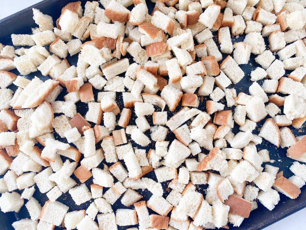 small bread cubes on a tray drying