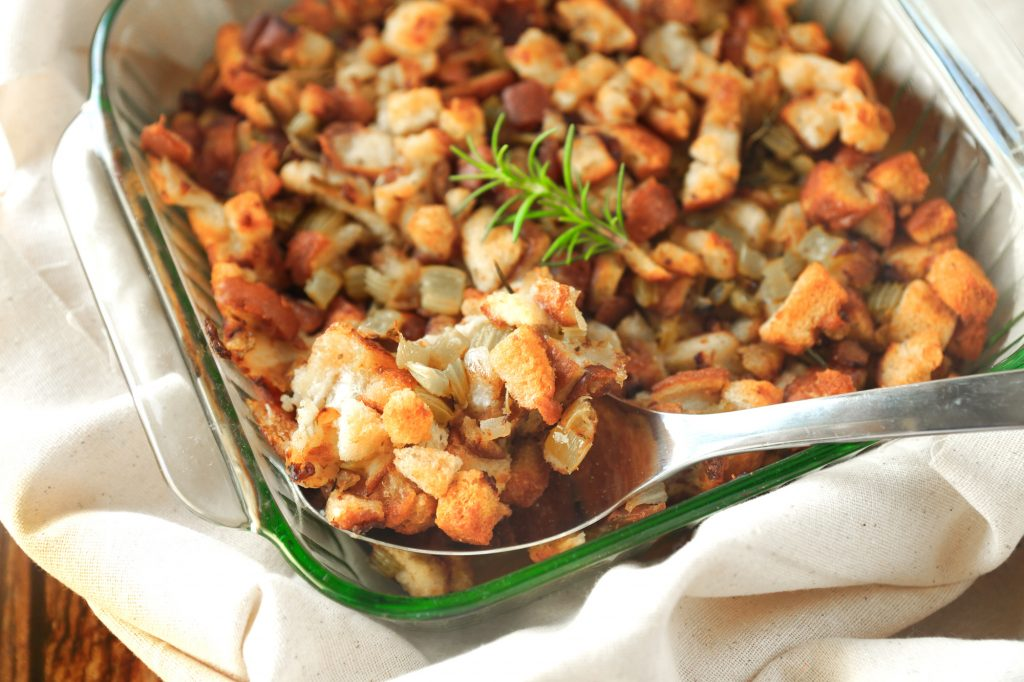 vegan stuffing being scooped out with serving spoon