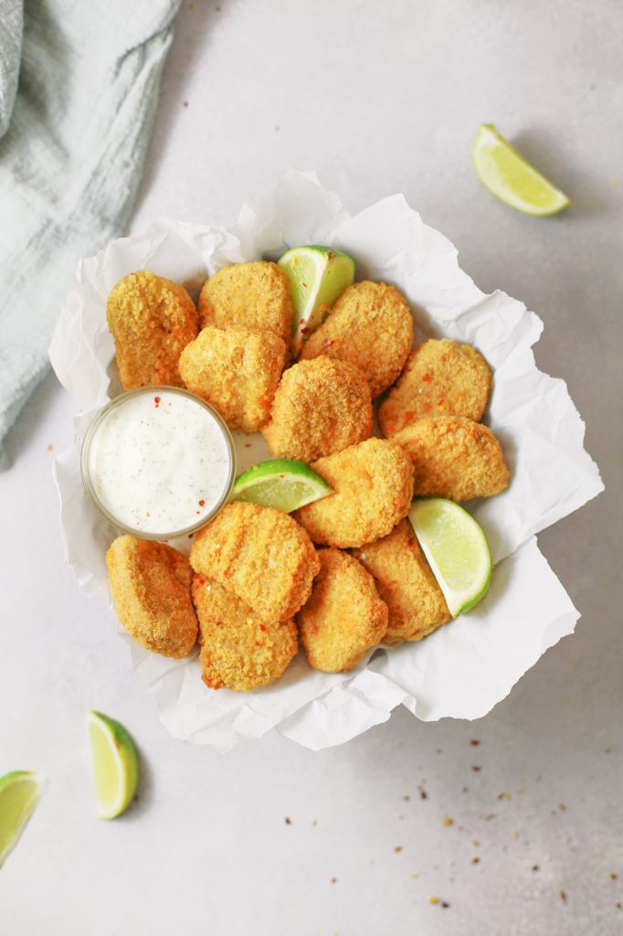 crispy baked vegan tofu nuggets in bowl with dressing
