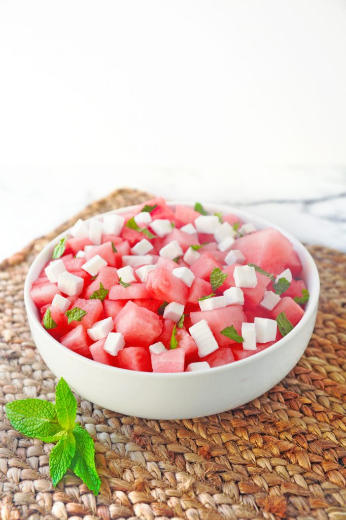 vegan watermelon salad on brown placemat