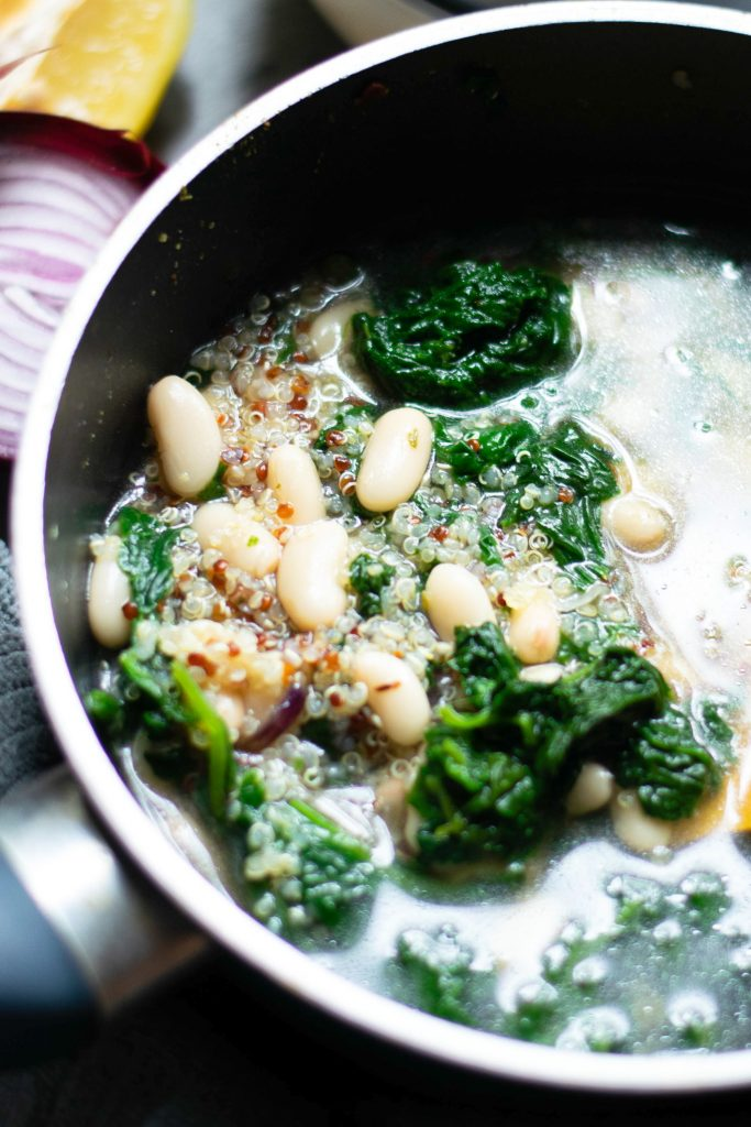 close up of vegan white bean soup cooking in soup pot