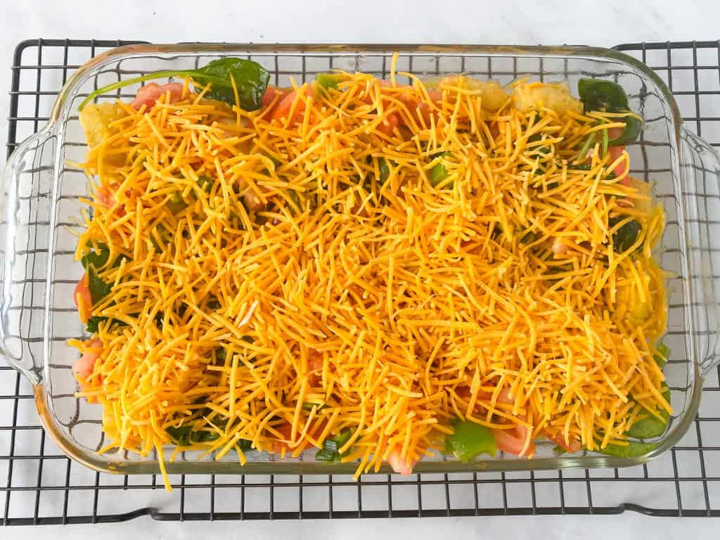 vegetarian breakfast casserole before baking with cheese and veggies