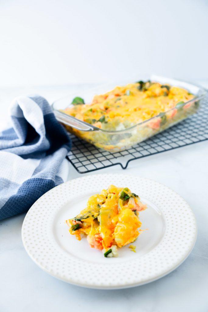 slice of vegetarian egg bake with blue towel