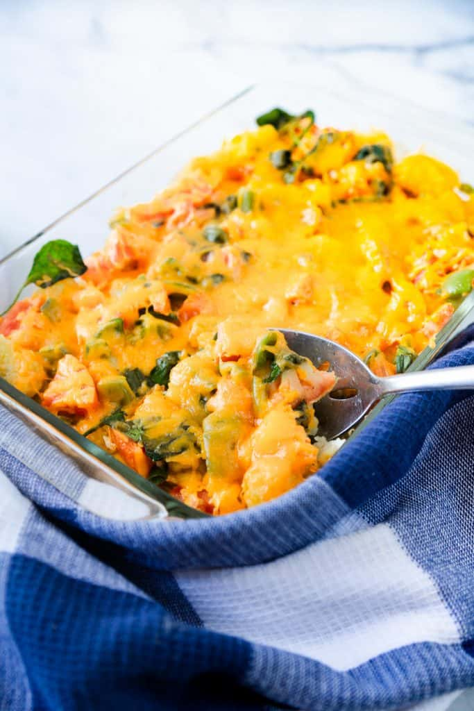 vegetarian breakfast casserole with a scoop being taken out of it