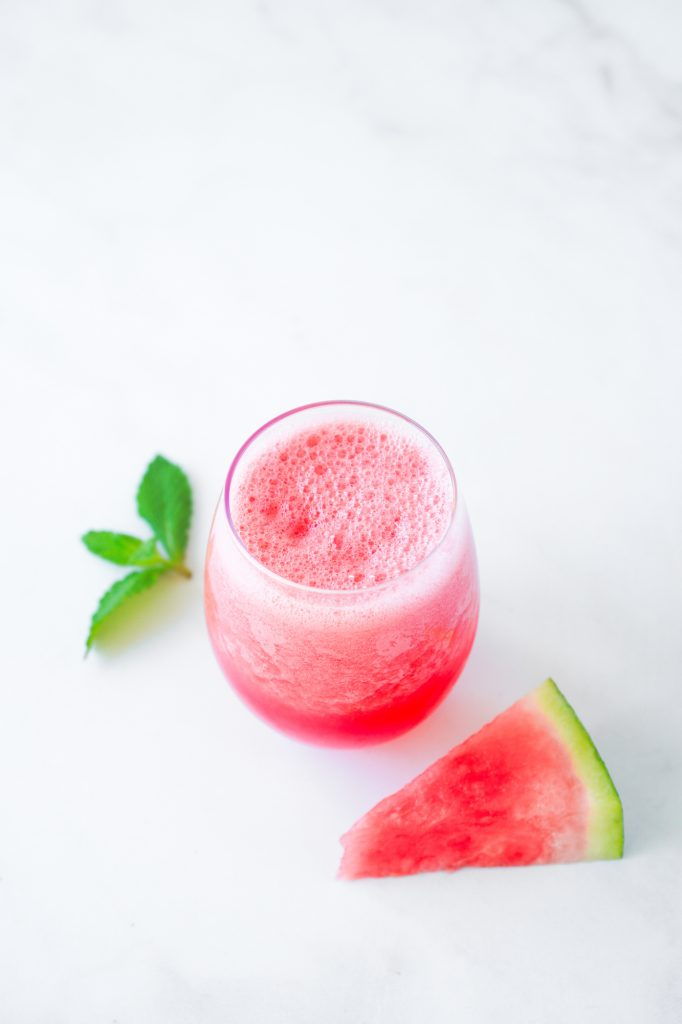 top down view of smoothie in glass with watermelon