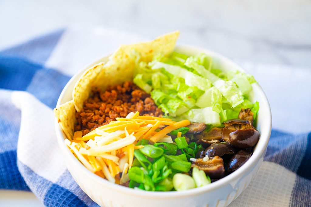 close up photo of a vegan burrito bowl recipe with blue checked towel
