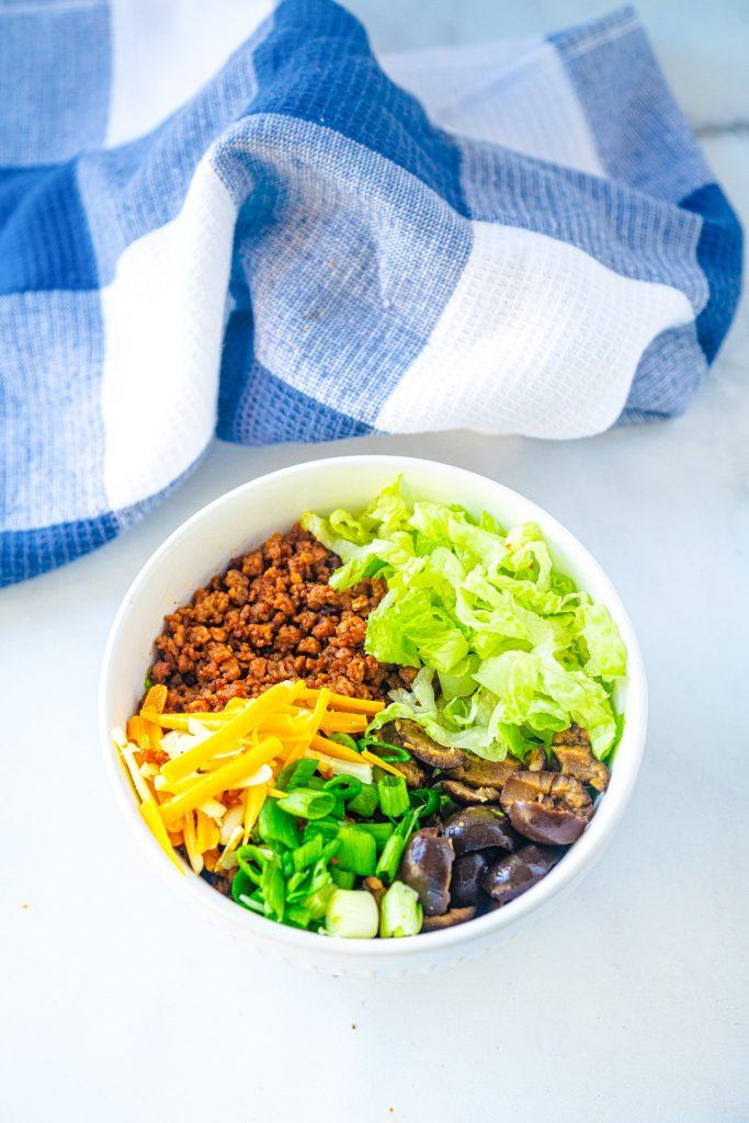 vegan burrito bowl topped with veggies