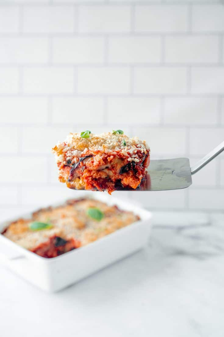 vegan eggplant parmesan being served on a spatula