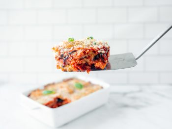 spatula picking up a slice of vegan eggplant parmesan