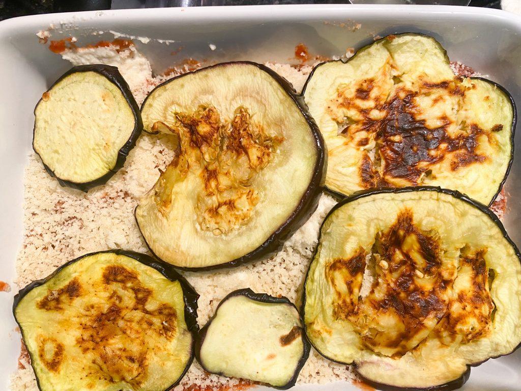 assembling vegan eggplant parmesan