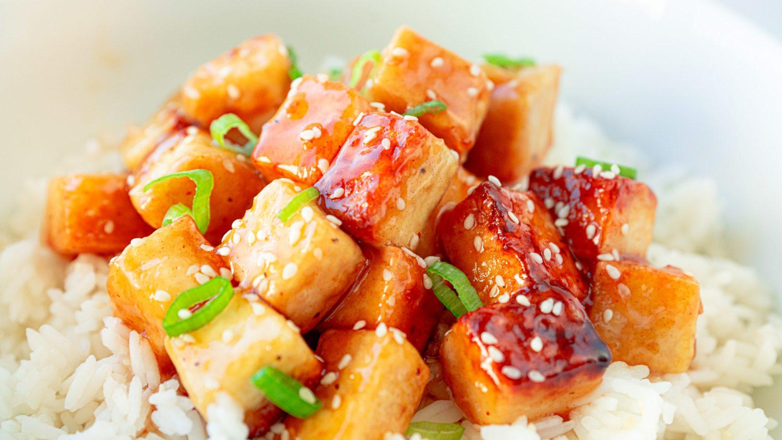 vegan orange tofu over white rice