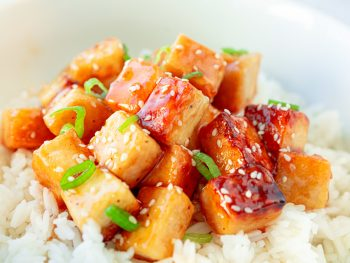vegan orange tofu over white rice