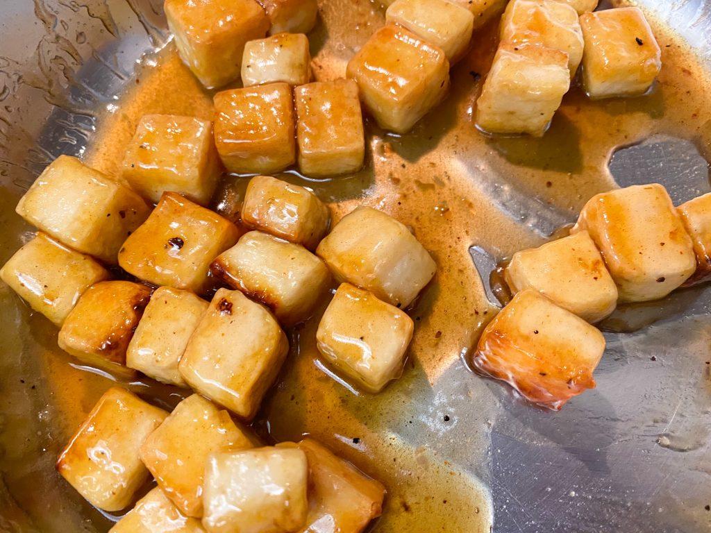 vegan orange tofu tossed in orange sauce