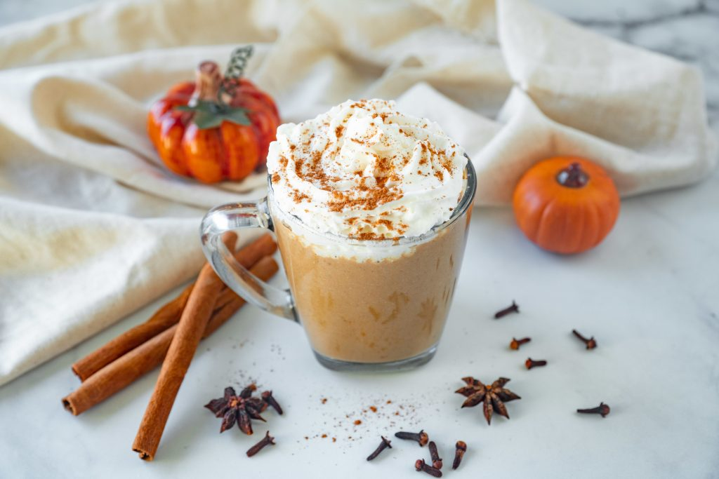 vegan pumpkin spice latte with whipped cream and cinnamon sprinkles