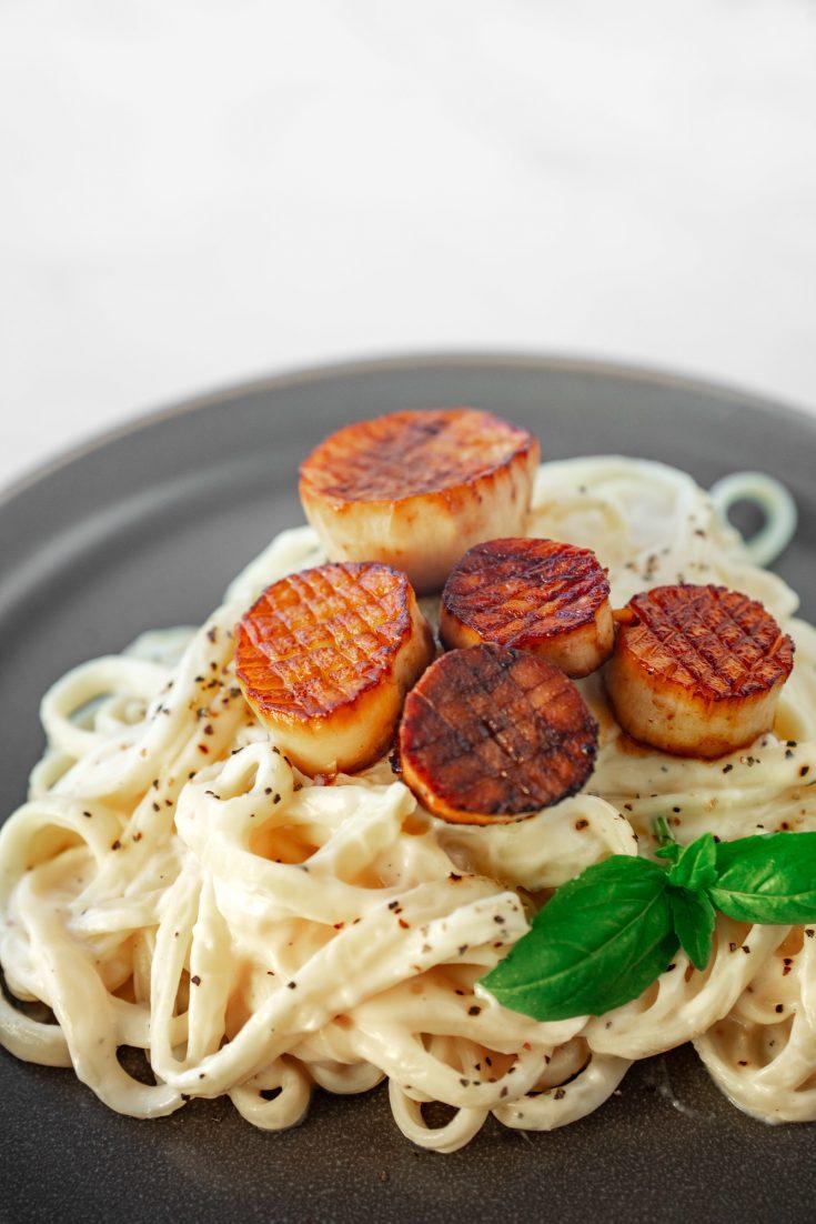 vegan scallops on top of alfredo pasta