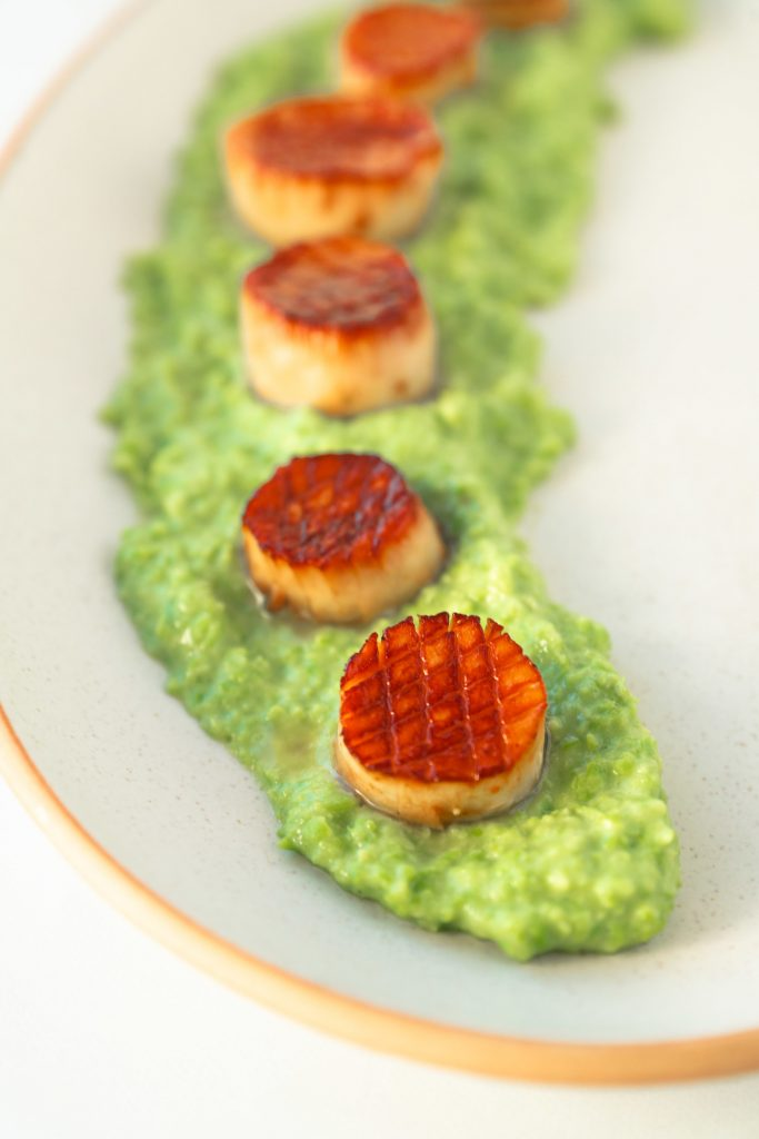 close up of vegan scallops on truffle pea puree