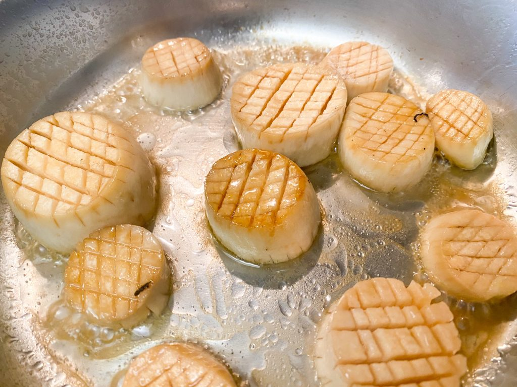 beginning process of cooking vegan scallops out of king oyster mushroom stems