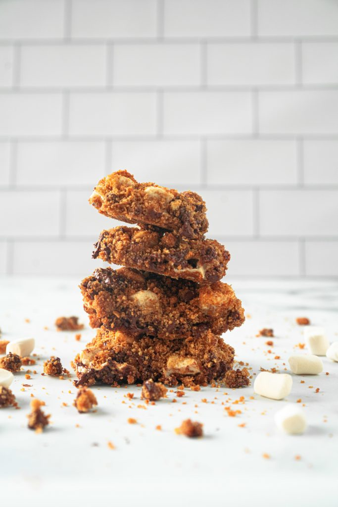 stacked vegan smores bars on kitchen counter