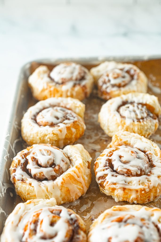 vegan cinnamon rolls from puff pastry on baking sheet