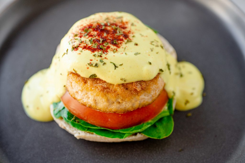 close up image of vegan eggs benedict made from tofu