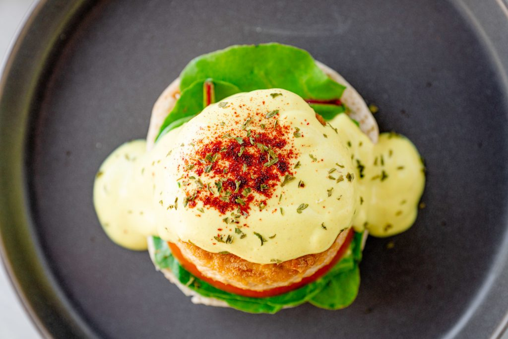 top view of a vegan eggs benedict with hollandaise sauce
