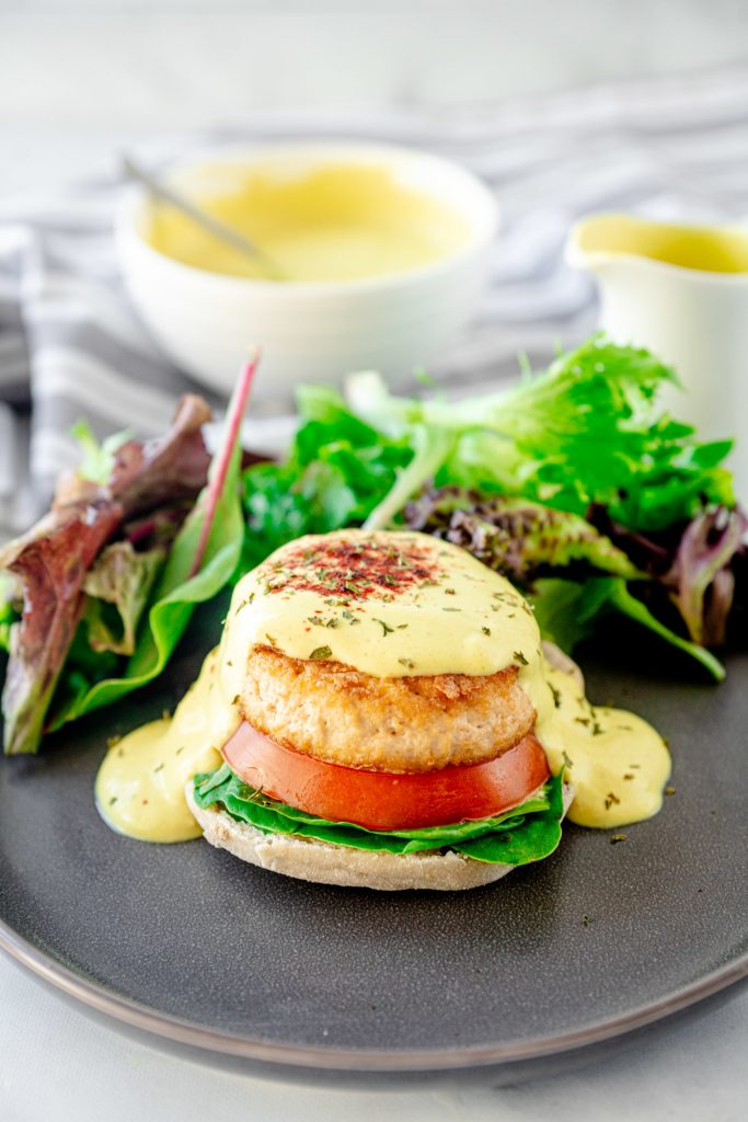 vegan eggs benedict with a salad on a plate