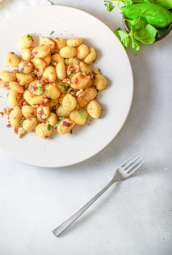 vegan gnocchi on plate with basil