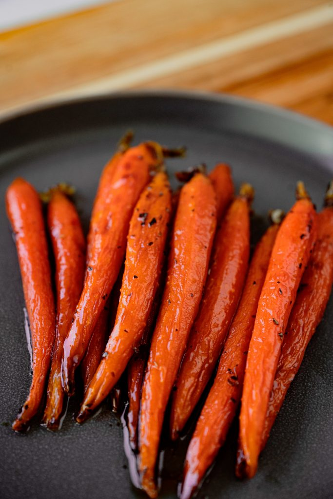 oil free and vegan maple glazed carrots on serving dish