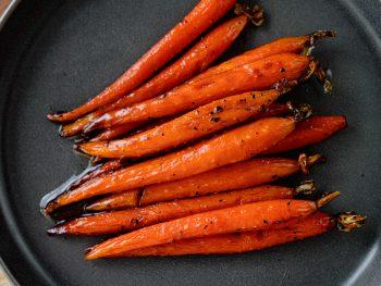 vegan maple glazed carrots on black plate