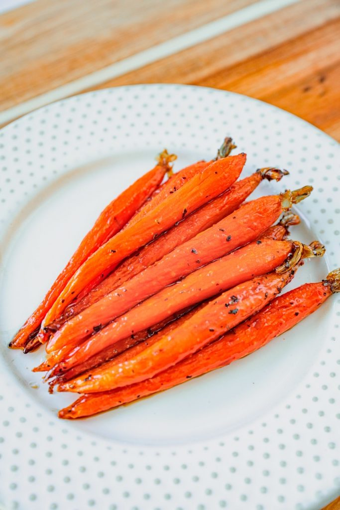 vegan maple glazed carrots on white plate