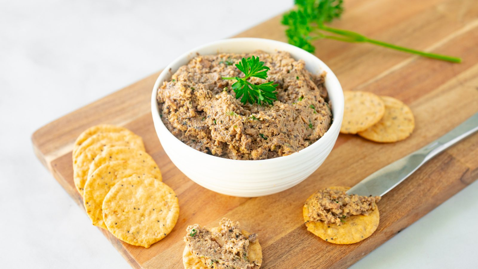 vegan pate with mushrooms and walnuts on serving platter