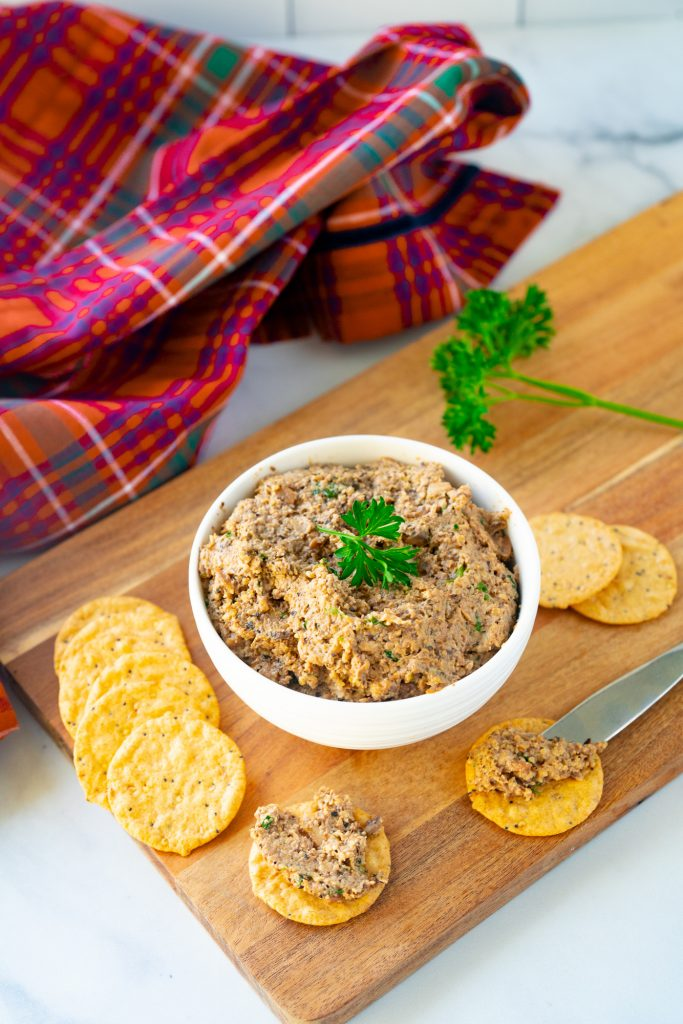 plaid towel with a bowl of vegan pate and crackers