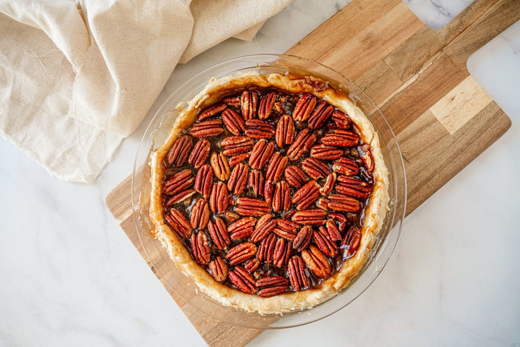 above photo of vegan pecan pie whole and baked