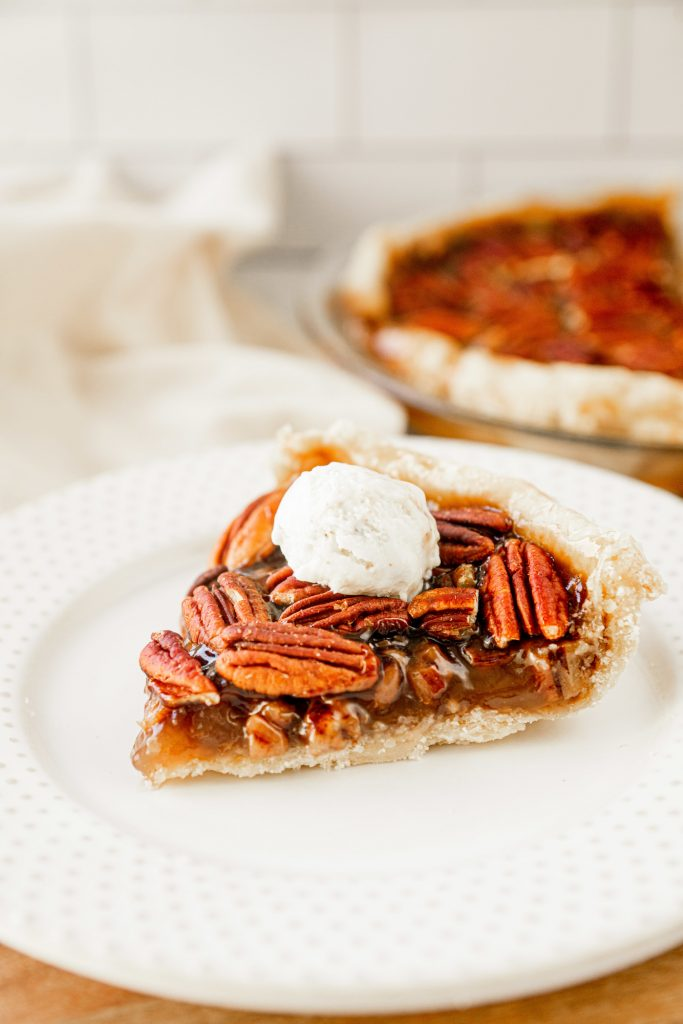 vegan pecan pie with ice cream on plate